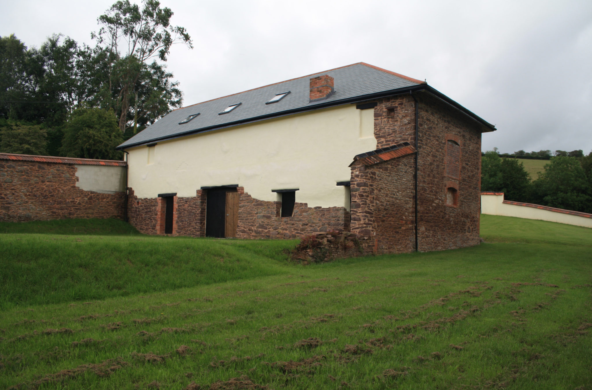 Planning permission granted for the retention and use of a rebuilt barn